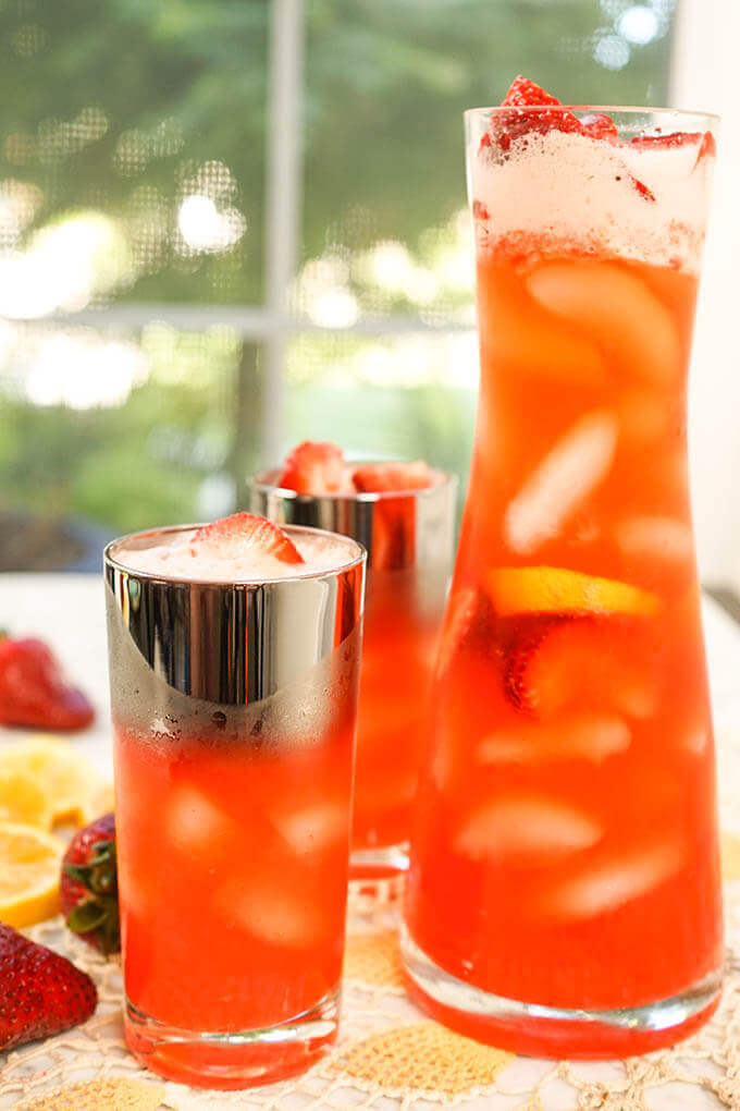 How to make strawberry lemonade and Glasses and pitcher filled with strawberry lemonade.
