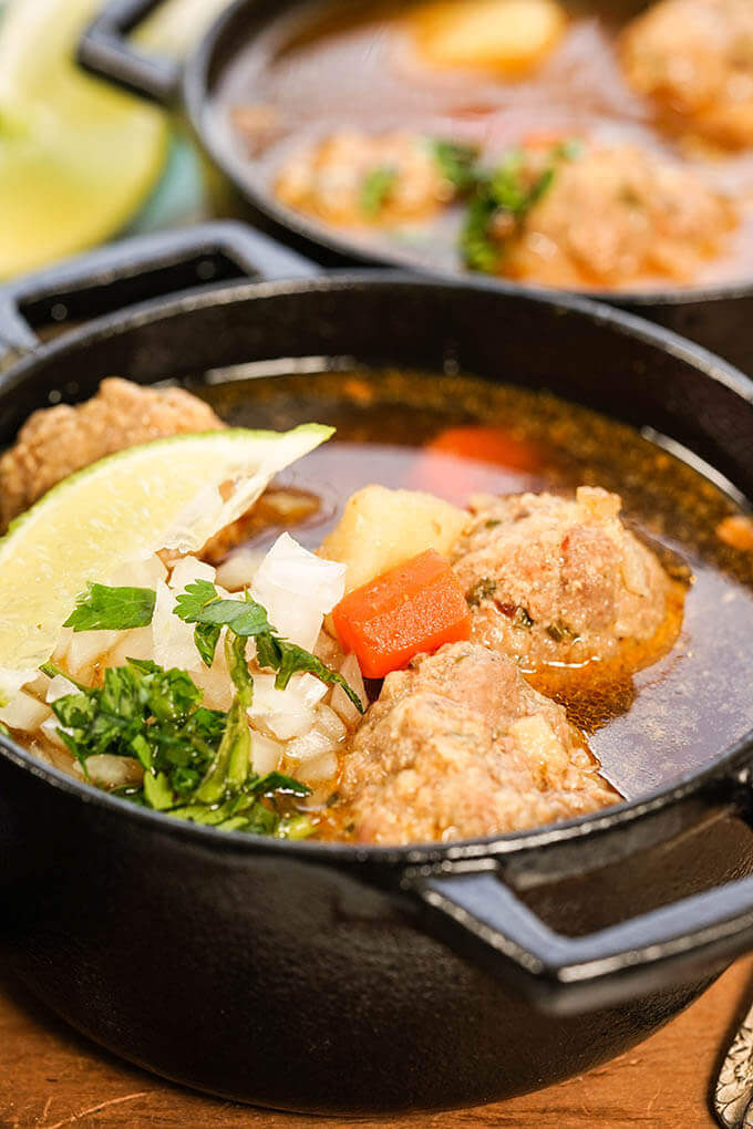 Mexican Meatball Soup in cast iron bowls.