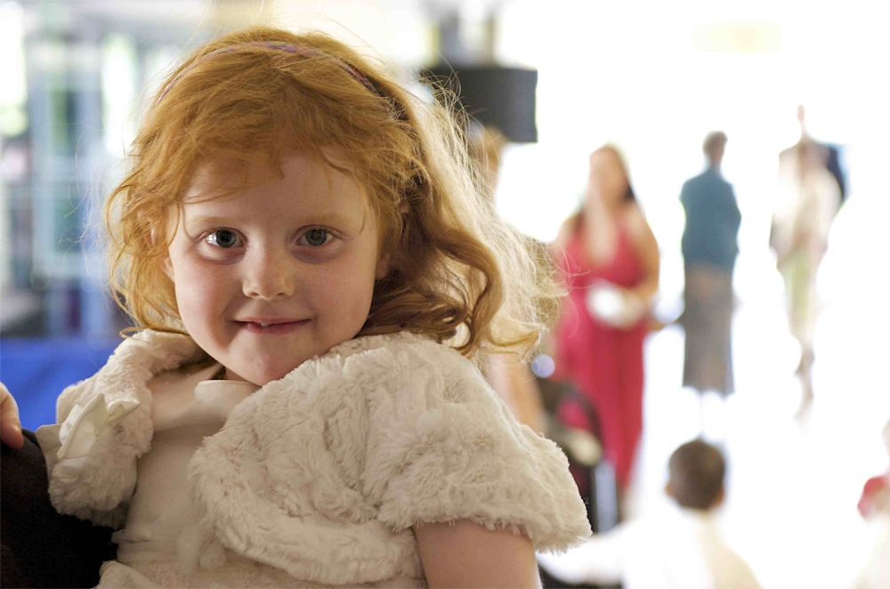 Picture of a child at the wedding of Tammy and Nick in Ely by cambridge photographer Richard Bowring