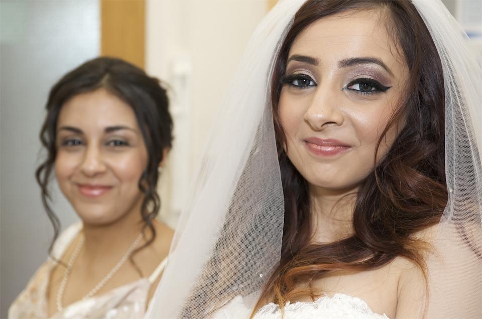 The bride and bridesmaid at the wedding of Adnan and Jasmina by cambridge based photographer Richard Bowring