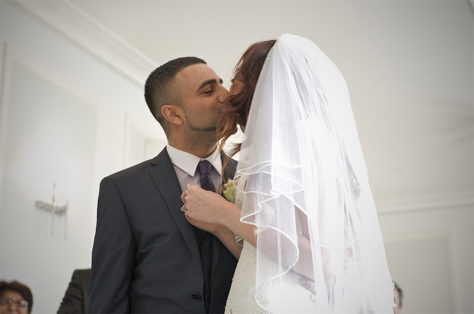 The bride and groom kiss at the wedding of Adnan and Jasmina by cambridge based photographer Richard Bowring