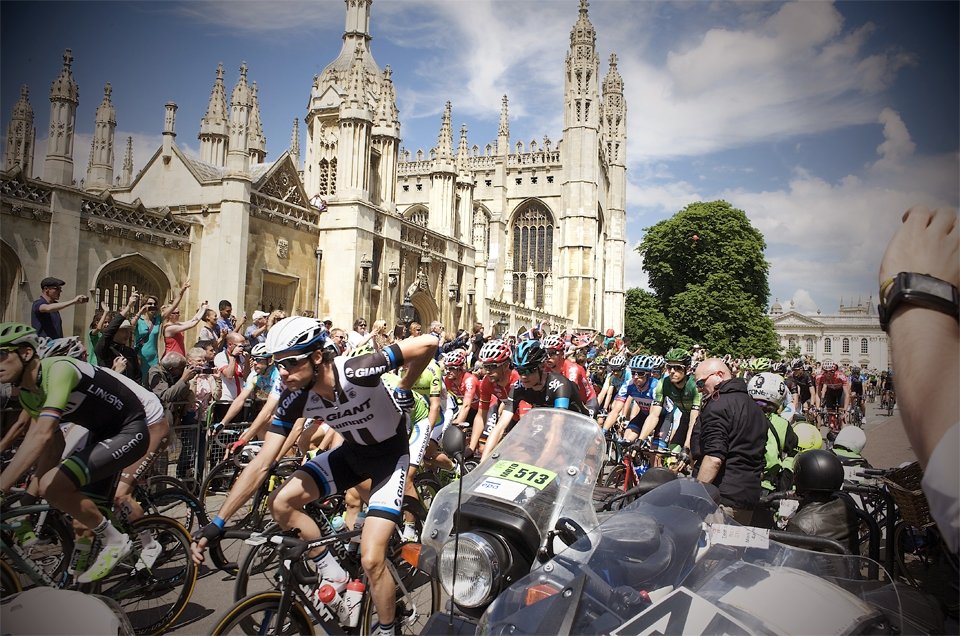 The peleton of the tour de france arriving in cambridge
