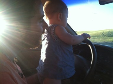 These two love to play at the wheel on trips. Mr taught Em how to honk the horn. Soooo fun.