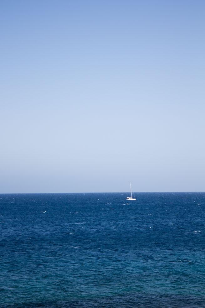 lanzarote teguise beach ocean view boat