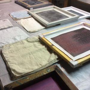 Preparing to print on vintage napkins