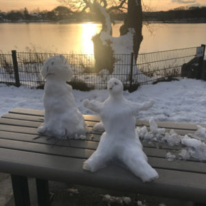 Snow People at Sunset