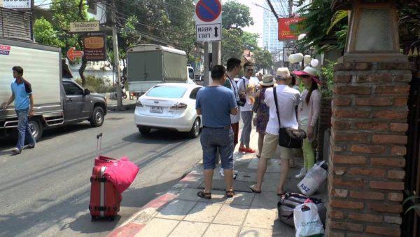 Tourists Stopped on Sidewalk