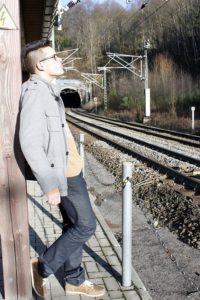 Sad guy near train tracks
