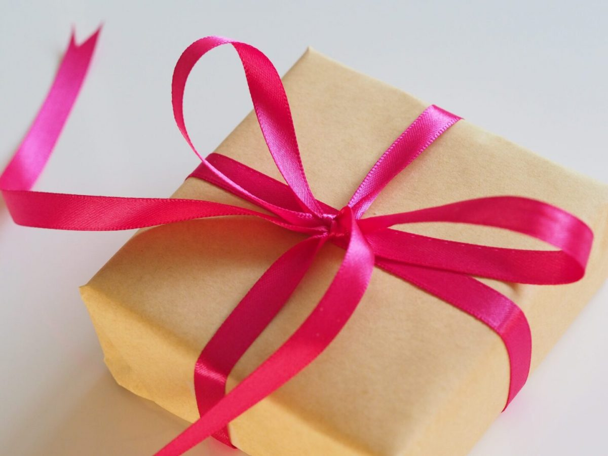 gift for her - gift wrapped parcel with pink ribbon