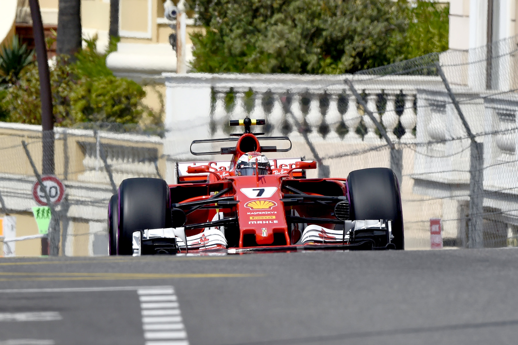 Kimi Raikkonen takes his Ferrari to pole position in Monaco