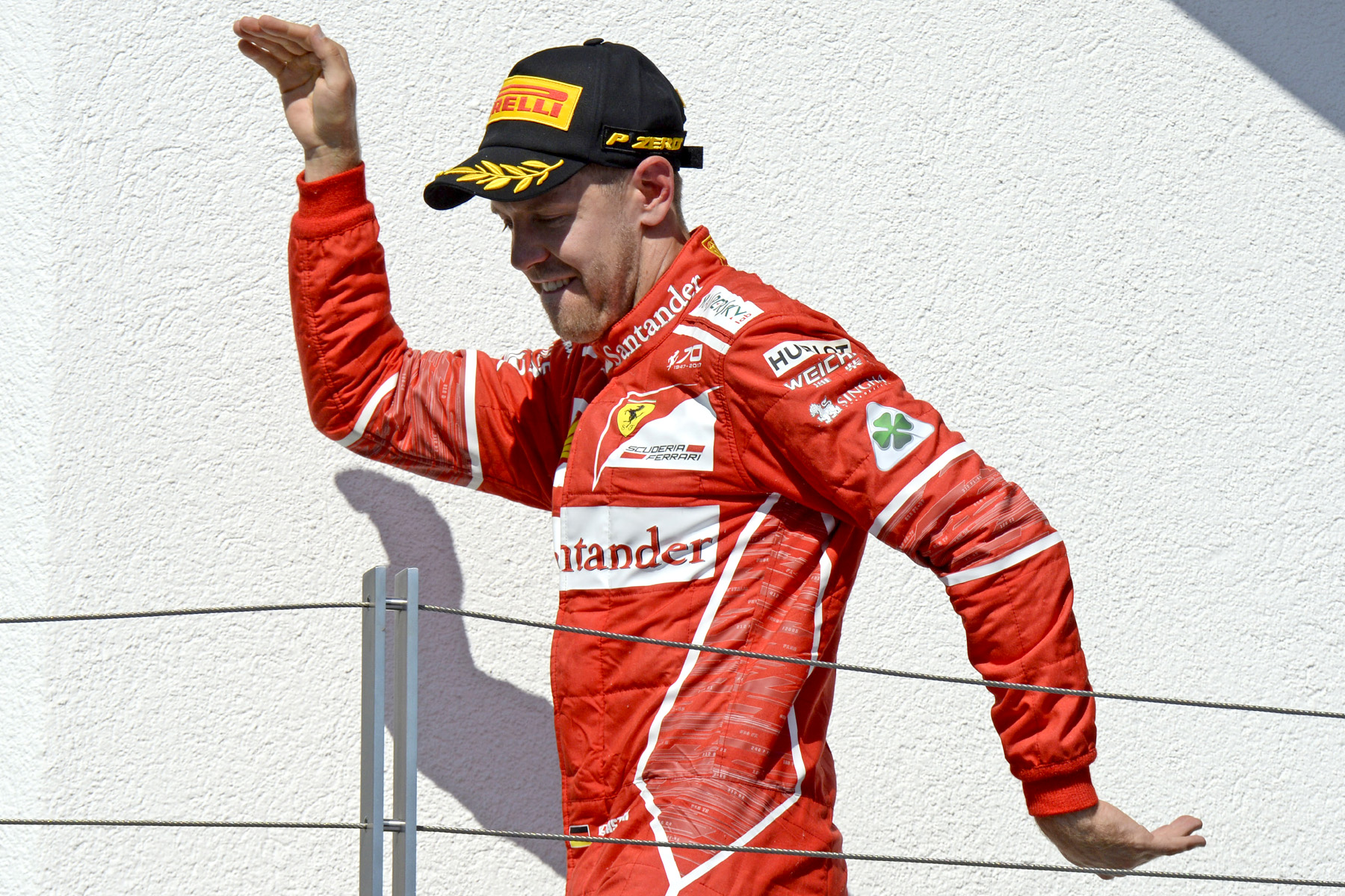 Sebastian Vettel celebrates victory on his way to the 2017 Hungarian Grand Prix podium.