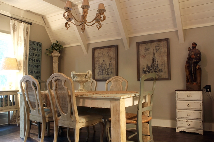 French country dining room w/ farmhouse table and cane chairs, St. Francis statue