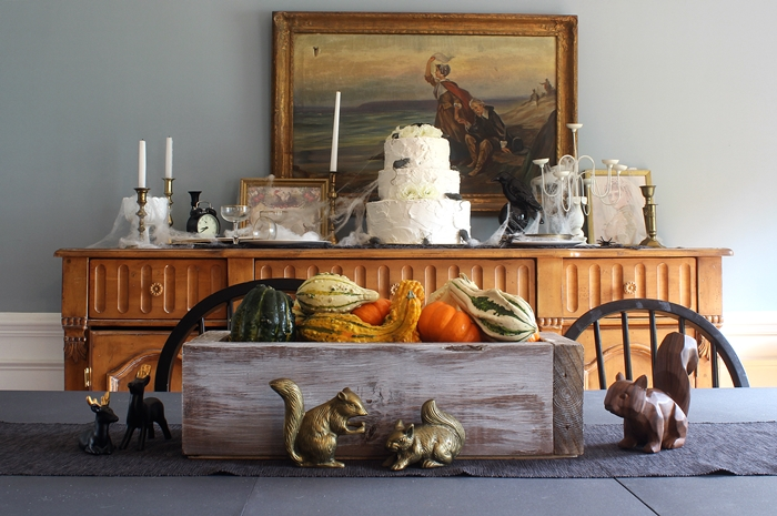 whitewashed box with gourds