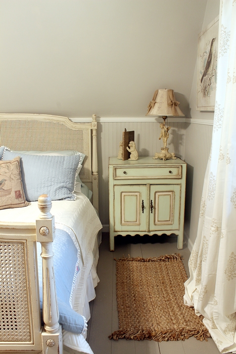 bedside table in french country bedroom