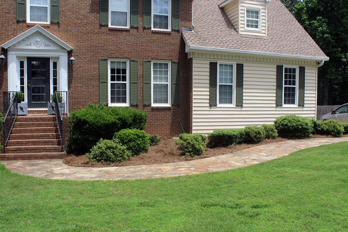 front garden bed mulched with pine straw