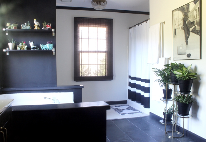black and white master bathroom with vintage planters