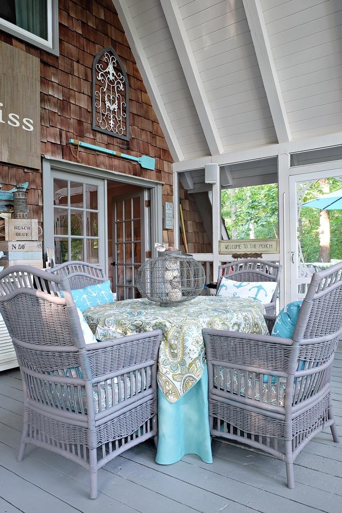 wicker table and chairs on screen porch