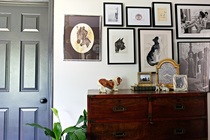 campaign chest and gallery wall in master bathroom