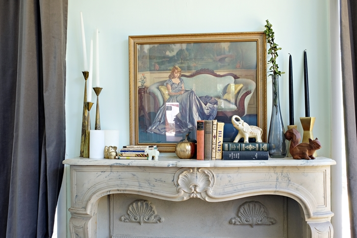 mantel with lots of vintage finds