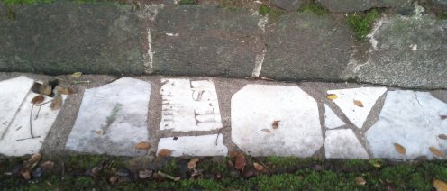 Bits of headstones from the cemetery used as ditch pavers. Note that you can see words on one piece!