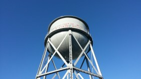The water tower, restored with its historic graffiti.