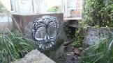 Beautiful graffiti in an old structure below the berm.