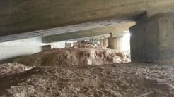 Dirt berms under the roadway.