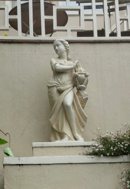 """This statue cracks me up. Methinks it's a drag queen, judging by her, um, """"package."""""""
