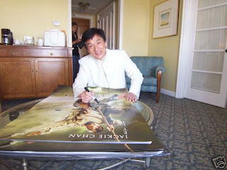 Forbidden Kingdom - Jackie Chan is signing a poster for the auction.
