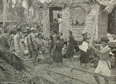 Philippines People Filipino Pinoy Pilipinas Old Black White Pictures evacuation leyte world war II WWII house nipa hut street scene noon