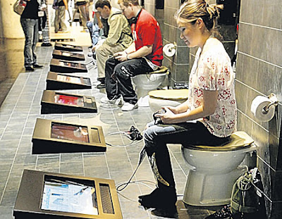 Visitors playing Playstation while sitting on toilet seats