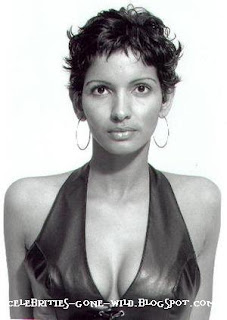 Seriously McmIllan she so ghetto celebrity look a like halle berry