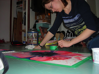 Angela Fehr working on a recent painting