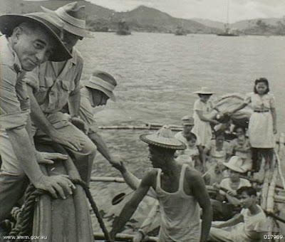 Philippines People Filipino Pinoy Pilipinas Old Black White Pictures christmas day festive ship australian soldiers boaat banca leyte tug noon