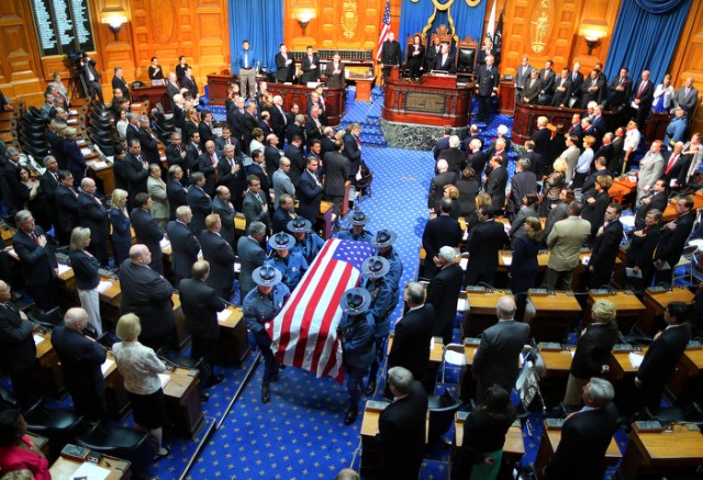 Boston-06/12313-  A Remembrance for former Gov. Paul Cellucci was held at the State House House of Representatives, where friends, family and politicians attended. State Police pallbearers carry the casket after the service.