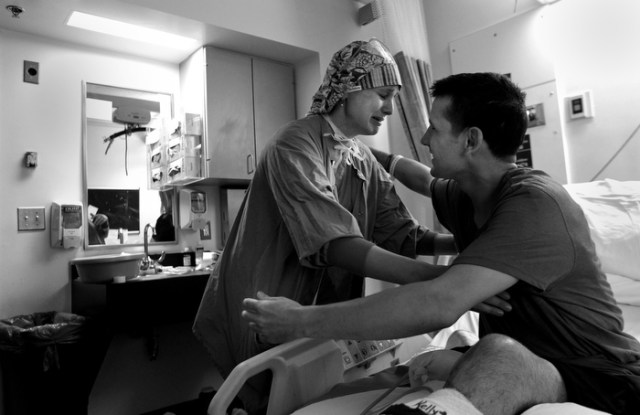 In tears, nurse Amanda Heidbreder  says goodbye to Marc in his hospital room during his discharge to the Spaulding Rehabilitation Hospital. Marc, a charmer with time for everybody, instantly became a hit with the hospital staff during his stay.