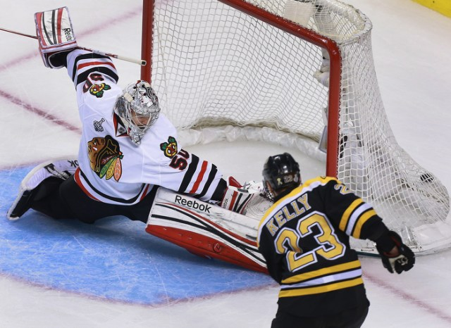 Chris Kelly of the Bruins scores to put Boston ahead in the game.