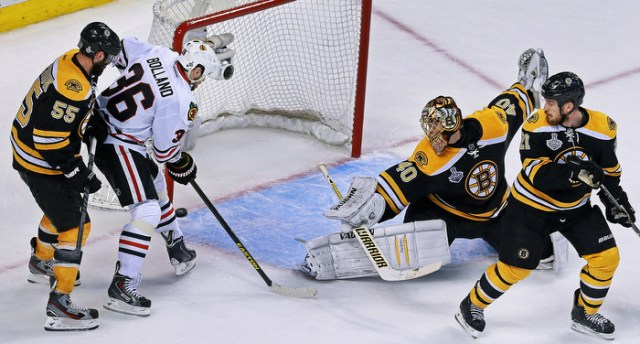17 seconds after they tied the game, Chicago's Dave Bolland scores the game winning goal and the Bruins Johnny Boychuck, Tuuka Rask and Andrew Ference can only watch.