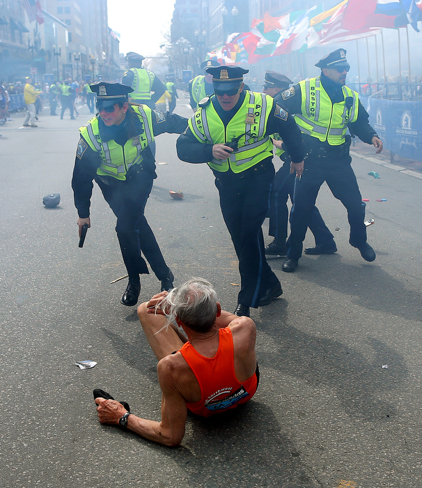 Boston-4/15/13- Boston Police officers Rachel McGuire, Kevin McGill and Javier Pagan react to a second  terrorist bomb exploding at the Boston Marathon. The first bomb knocked down runner Bill Effrig on Boylston Street near the finish line.