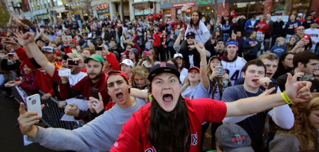 Boston Red Sox fans celebrate during a parade in celebration of the baseball team's World Series victory, Saturday, Nov. 2, 2013, in Boston.