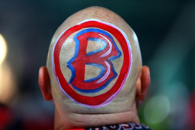 """Boston-10/30/13--World Series game 6-  Don Smead from Putney VT. wears a """"B"""" on his bald head as he attends his 1289th Red Sox game."""