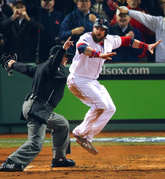 Boston-10/30/13--World Series game 6- Jonny Gomes is signaled safe by the home umpire as he scored in the 3rd inning on a Shane Victorino 3-run rbi double.