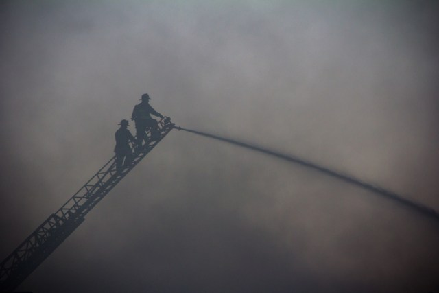 September 2, 2014 - Firefighters respond to a 9-alarm fire on Harvard Terrace in Boston, Mass.