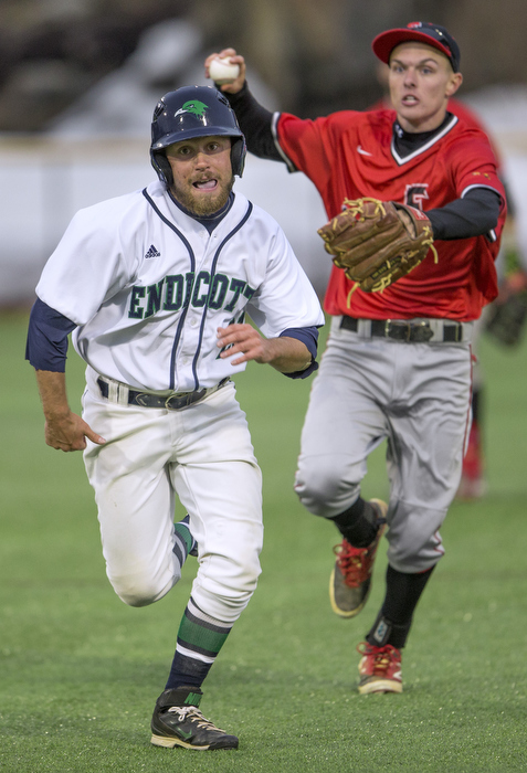 Caught in a rundown while trying to steal second base, Endicott's Cam Farnam is pursued by Eastern Nazarine College's second baseman Jeremy Wagner who threw to first to make the out. Fourth inning action, North Field, Beverly, MA, 3/27.