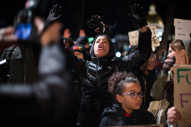 "Boston. Dec. 4, 2014. Protestors chanted slogans such as ""Black Lives Matter"" and ""I can't breath"" as they stood at Boston Common during the tree lighting ceremony on Thursday night."