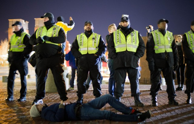 Boston. Dec. 4, 2014. A protestor lays down in front of Boston Police offcers near the Government Center during the protest.