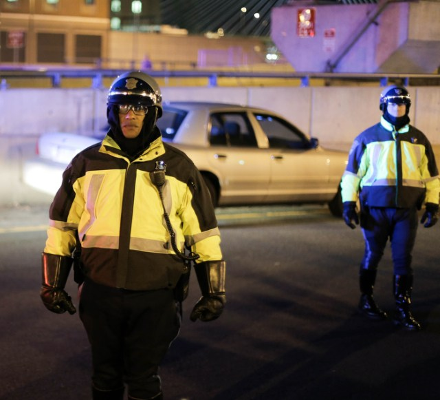 Boston. Dec. 4, 2014.  Boston and State police officers prevent protestors from getting on the interstate on Thursday night.