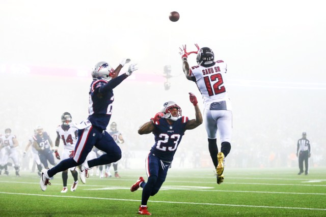 FOXBORO, MA - OCTOBER 22: Mohamed Sanu #12 of the Atlanta Falcons catches a pass as he is defended by Patrick Chung #23 of the New England Patriots during the fourth quarter of a game against the Atlanta Falcons at Gillette Stadium on October 22, 2017 in Foxboro, Massachusetts. The fog rolled into the stadium around halftime and caused visibility issues for those on the field and in the stands.