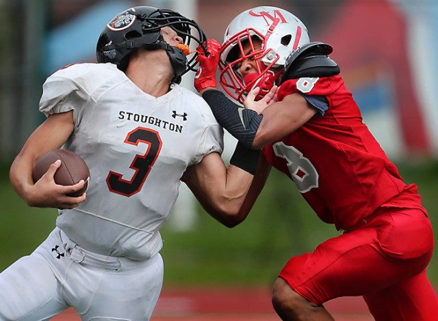 West Roxbury   Ma     9/16/17  Stoughton High runningback Justin Ly is facemasked by Catholic Memorial High Khari Johnson during second half action at Catholic Memorial.