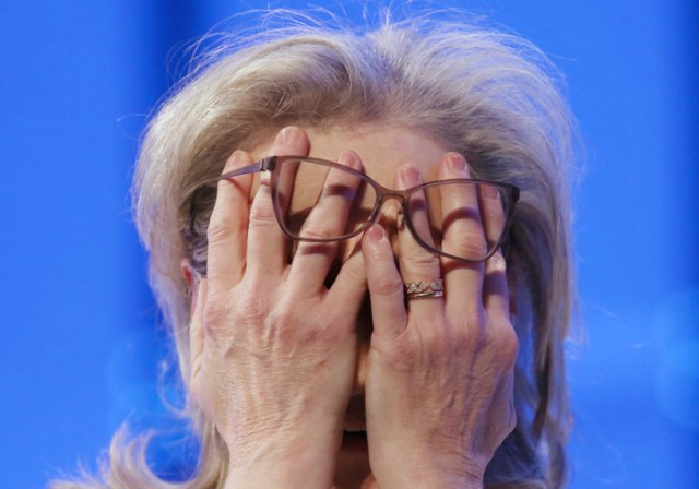 Actress Meryl Streep covers her face as she participates in a conversation with Gloria Steinem during the Massachusetts Conference for Women at the Boston Conference and Exhibition Center, Thursday, December 7, 2017.